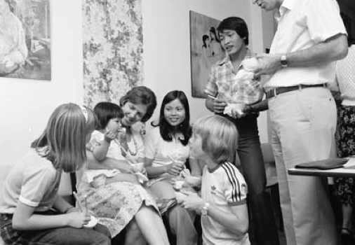 Community Refugee Settlement Scheme hosts with Vietnamese refugee in Canberra (Photo from National Archives of Australia NAA A12111, 2/1980/46A/7)